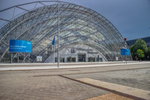Leipzig, Germany-August 28,2019. View of the entrance area with the glass hall and the congress center of the trade fair grounds of Leipziger Messe, Germany, taken from the forecourt, Shutterstock