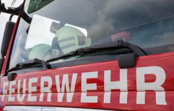 """Luebeck, Germany - Sept 2, 2017: German fire engine with """"Feuerwehr"""" sign (engl.: fire brigade), Shutterstock"""